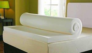 a mattress topper on a bed