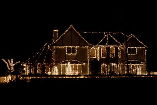 photo of a house with many lights on