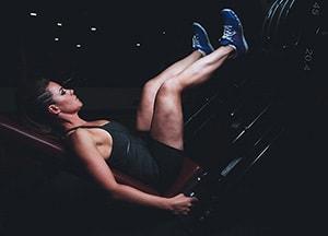 image of a woman exercising at night