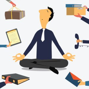 image of a man meditating with busy work happening around him