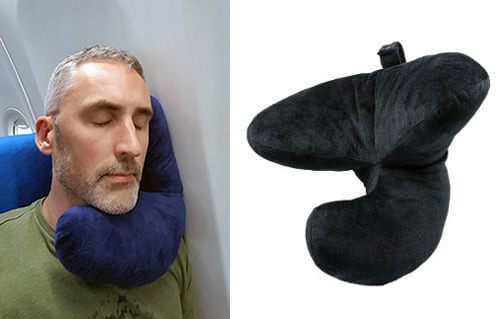 photo of ethan green sleeping with the j-pillow on a plane journey