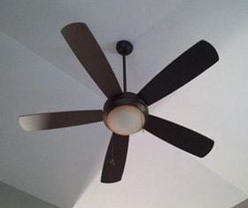 A Ceiling Fan In A Bedroom