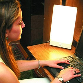 woman using a biobrite light box