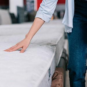 person choosing a mattress topper