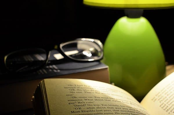 A book on a bedside table