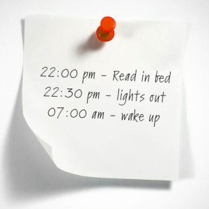 image with writing saying: lights out at 22:30 and wake up at 07:00