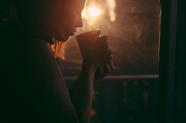a woman drinking tea before bed