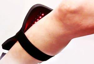 a near infra red light device on a leg