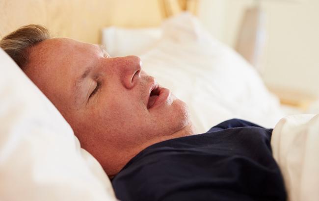 photo of a man snoring