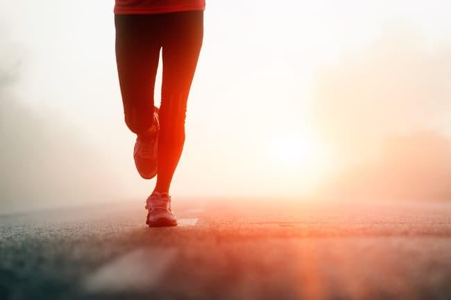 photo of a man running at night