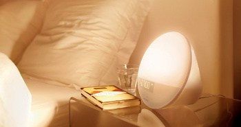 image of a wake up light next to a bed