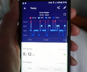 photo of my phone with the fitbit sleep app on the screen
