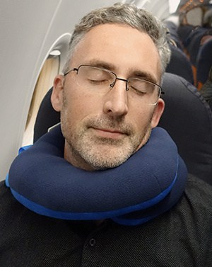 photo of me wearing the me wearing the bcozzy travel pillow