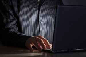 man working late at night on a laptop