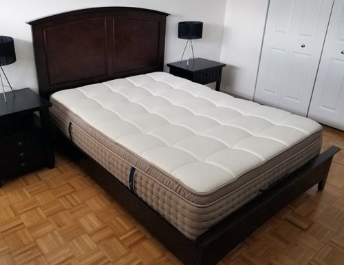 image of the dreamcloud mattress in a bedroom with no bed covers