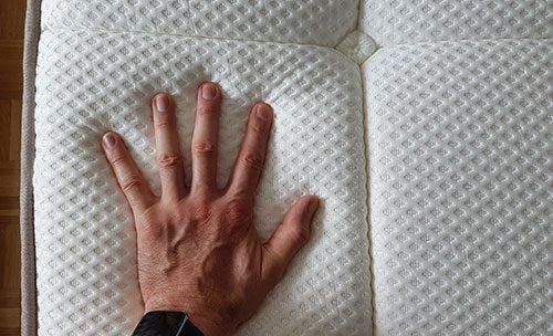 photo of me testing the dreamcloud mattress density