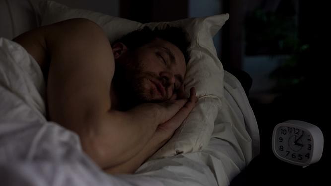 photo of a man sleeping