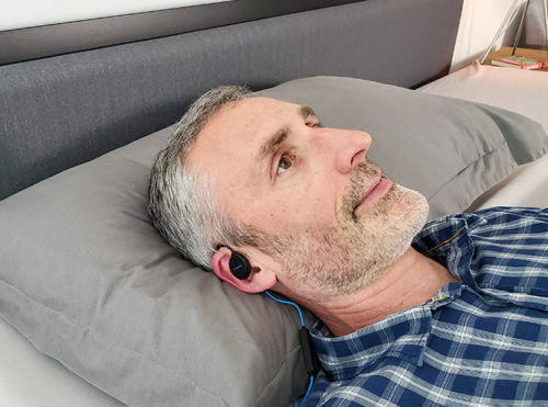 photo of ethan green wearing the dublabs bedphones in bed