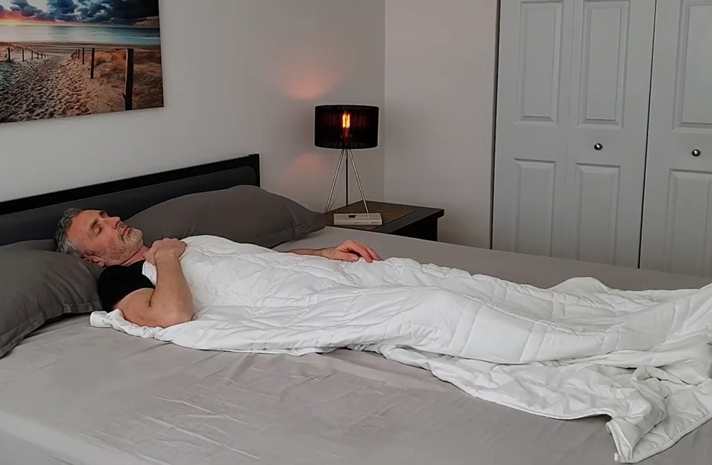 ethan green using the baloo weighted blanket in his bedroom