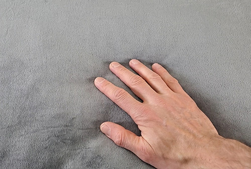 the minky cover of the luxome weighrd blanket with a hand touching it
