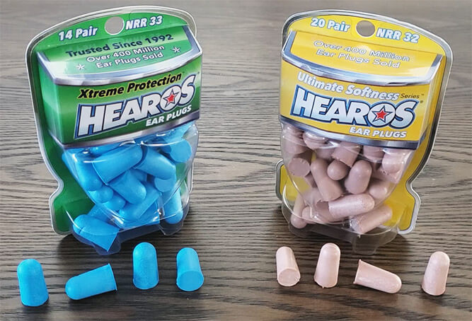 photo of a pack of hearoes xtreme protection and a pack of hearoes ultimate softness, with four pairs of the earplugs on a table to show the dimensions