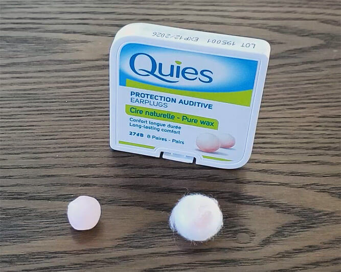 a pack of quies wax eaplugs, and two example wax balls ready to use