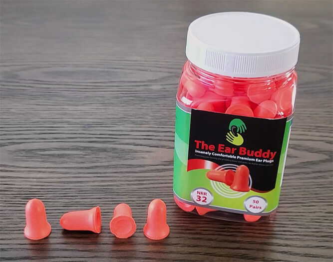 photo of the ear buddy earplugs, with a pot of 50 and four loose earplugs showing different angles